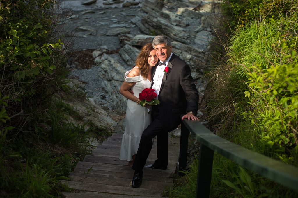 Picture of Cliff and Liza on steps to beach at Castle Hill