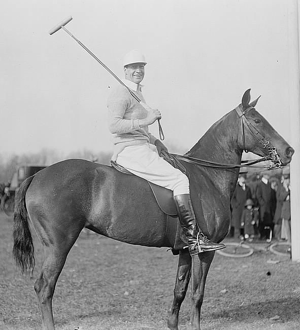 RL Agazzi on horseback playing polo